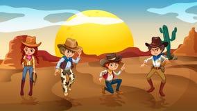 Cowboys et une cow-girl au désert Images libres de droits