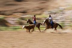 Cowboys on horseback Stock Photography