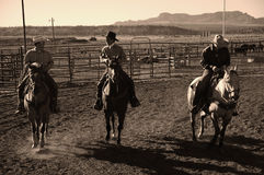 Cowboys on horses. BRICE CANYON CITY, UTAH - JUNE 25: Cowboys ride their horses at a rodeo show at Ruby's Inn Bryce Canyon Country Rodeo on June 25, 2011 in Stock Photo