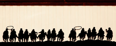 Cowboys on horses Stock Images