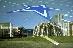 Cowboys huddle and The Star sign in Frisco TX stock image
