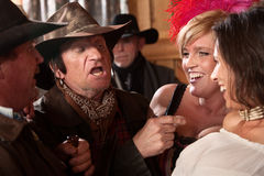 Cowboys Joking With Pretty Women Stock Image