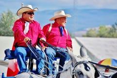 Cowboys parade riding cart montana usa Stock Images