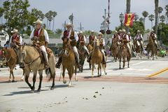 Cowboys riding down street on horseback during opening day parade down State Street, Santa Barbara, CA, Old Spanish Days Fiesta, A Royalty Free Stock Photos