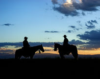 Cowboys silhouette. Cowboys on horseback. Silhouette against a great Montana dawn sky Royalty Free Stock Images