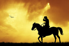 Cowboys silhouette at sunset Stock Images