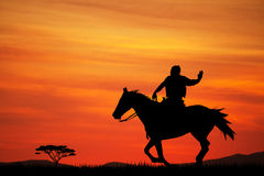 Cowboys silhouette at sunset. Illustration of cowboys silhouette at sunset Royalty Free Stock Image