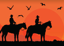 Cowboys silhouettes at sunset Stock Image