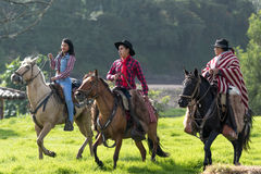 Cowboys taking a horseback ride. May 27, 2017 Sangolqui, Ecuador: cowboys taking a horseback ride outdoors in the high Andes during a rural rodeo royalty free stock photos