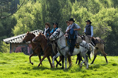 Cowboys taking a horseback ride Royalty Free Stock Photography