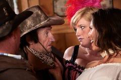 Cowboys Talking to Women Stock Image