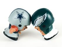 Cowboys v. Eagles Li`l Teammates Toy Figures. Cowboys v. Eagles, Li`lToy figures on a white backdrop Royalty Free Stock Photos