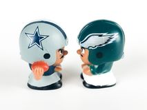 Cowboys v. Eagles Li`l Teammates Toy Figures. Cowboys v. Eagles, Li`lToy figures on a white backdrop Stock Photos