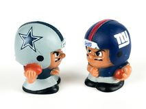 Cowboys v. Giants Li`l Teammates Toy Figures. Cowboys v. Giants, Li`l Teammates Toy figures on a white backdrop Stock Image