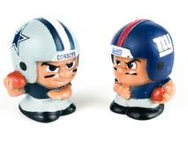 Cowboys v. Giants Li`l Teammates Toy Figures. On a white backdrop royalty free stock photos