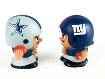 Cowboys v. Giants Li`l Teammates Toy Figures. On a white backdrop stock image