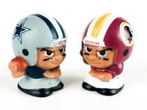 Cowboys v. Redskins Li`l Teammates Toy Figures. On a white backdrop royalty free stock image
