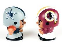 Cowboys v. Redskins Li`l Teammates Toy Figures. On a white backdrop royalty free stock photos