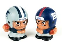 Cowboys vs. Giants Li`l Teammates Toy Figures. Cowboys vs. Giants, Li`lToy figures on a white backdrop Royalty Free Stock Photo