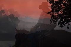 Cowboysilhouette. Arkivbild