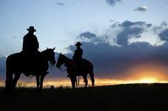 cowboysilhouettes Royaltyfri Bild