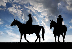 cowboyssilhouette Royaltyfria Foton