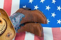 Cowboystiefel und Strohhut Stockbild