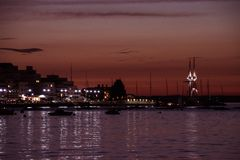 Cowes harbour after sunset, night time lights in homes and. Cowes Isle of Wight, harbour after sunset, home and street lights reflecting off the water royalty free stock photos
