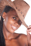 Cowgirl. Smiling young african american, cowboy girl , with leather hat, and braids Stock Photo