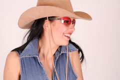 Cowgirl. A smiling young woman wearing a texan hat stock photo