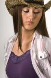 Cowgirl adolescente en tapa y sombrero del tanque Imagenes de archivo