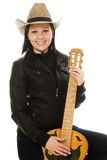 Cowgirl in ahat with acoustic guitar Stock Images