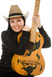 Cowgirl in ahat with acoustic guitar Royalty Free Stock Photography