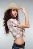 Cowgirl atractivo en sombrero foto de archivo