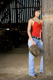 Cowgirl in barn doorway Royalty Free Stock Photo
