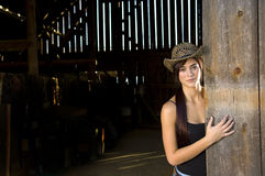 Cowgirl in barn doorway Stock Images