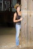 Cowgirl in barn doorway Royalty Free Stock Image