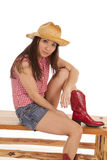 Cowgirl bench one leg up Stock Image