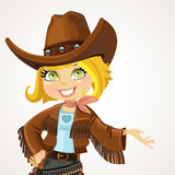 Cowgirl in big hat shows hand to the side and talking Royalty Free Stock Photography