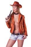 Cowgirl biondo sexy che salta una pistola isolata Fotografie Stock Libere da Diritti