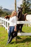 Cowgirl and black beauty Stock Photography