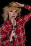 Cowgirl blowing on gun Royalty Free Stock Photos