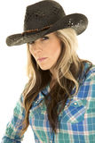 Cowgirl blue shirt close black hat looking Royalty Free Stock Photography