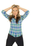 Cowgirl blue shirt hands in hair Stock Images