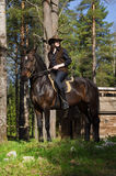 Cowgirl on brown horse Royalty Free Stock Images