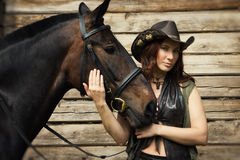 Cowgirl and brown horse Royalty Free Stock Image