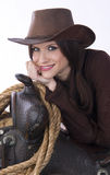 Cowgirl Candid Woman Leans on Saddle Gear Stock Photo