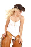 Cowgirl chaps hold both. A cowgirl has both hands on her chaps and looking to the side royalty free stock photography