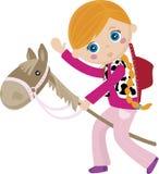 Cowgirl che guida un bastone, cavallo del burattino Fotografia Stock Libera da Diritti