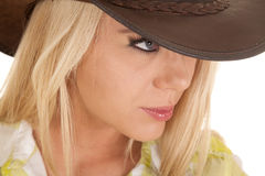 Cowgirl close head hat green plaid look side Stock Photo